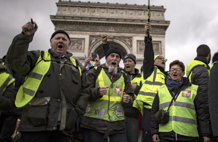 epa07424930 Protesters from the 'Gilets Jaunes' (Yellow Vests) movement walk down the Champs Elysees avenue near the Arc de Tiomphe during the 'Act XVII' demonstration (the 17th consecutive national protest on a Saturday) in Paris, France, 09 March 2019. The so-called 'Gilets Jaunes' is a grassroots protest movement with supporters from a wide span of the political spectrum, that originally started with protest across the nation in late 2018 against high fuel prices.  EPA/IAN LANGSDON