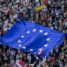 epa07625819 A large EU flag is displayed as thousands of demonstrators gather to protest against Czech Prime Minister Andrej Babis and new Minister of Justice at the Wenceslas Square in Prague, Czech Republic, 04 June 2019. Babis is suspected of alleged misuse of EU subsidies in a total of 50 million Czech crowns (1.9 milion euro) which were invested into the Capi hnizdo (Stork's Nest) farm in Central Bohemia. The EU's fraud office OLAF is investigating the case. In additional, last week Czech media reported, the European Commission sent an audit to the Czech authorities that Czech Prime Minister Andrej Babis is in a conflict of interests due to continuing ties with his businesses.  EPA/MARTIN DIVISEK