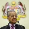 epa08251768 Malaysian interim Prime Minister Mahathir Mohamad reacts during an announcement of economic stimulus package to mitigate the impact of Covid-19 in Putrajaya, Malaysia, 27 February 2020. Some 46 Malaysian passengers and 20 non-citizens spouses arrived in Malaysia on 27 February on an evacuation flight from Wuhan.  EPA/AHMAD YUSNI