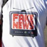 epa07849841 A Trump supporter wears a t-shirt reading 'Fake News' as he waits for the arrival of President Donald Trump in front of the Beverly Hills Hotel in Beverly Hills, California, USA, 17 September 2019. Trump is on a two-day trip to California to raise money for his 2020 election campaign.  EPA/ETIENNE LAURENT