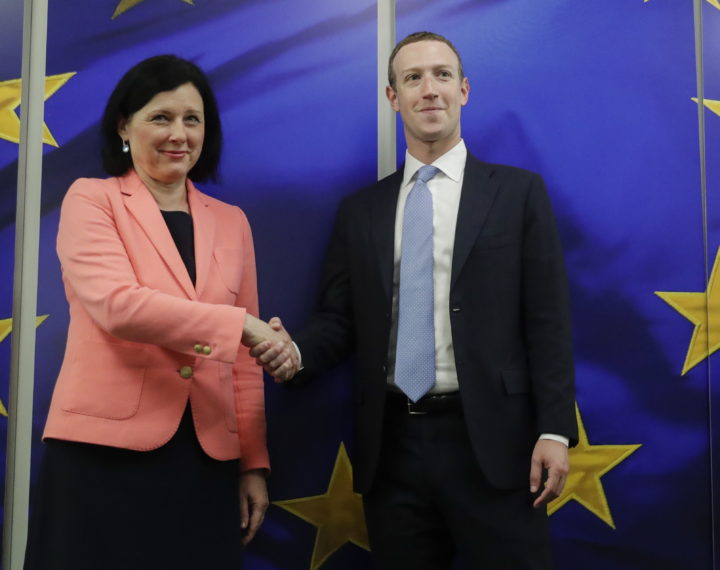 epa08223782 Facebook Ceo Mark Zuckerberg (R) is welcomed by European Commissioner for Values and Transparency Vera Jourova (L) prior to their meeting in Brussels, Belgium, 17 February 2020.  EPA/OLIVIER HOSLET