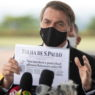 epa08424471 Brazilian President Jair Bolsonaro speaks to reporters at the entrance to the Palacio do Alvorada, in Brasilia, Brazil, 15 May 2020. Bolsonaro played down accusations of interference of the Federal Police corp, arguing he is protecting his family security. Bolsonaro also dealt with the resignation of health minister Nelson Teich on 15 May 2020 less than a month after Teich took the post amid the pandemic crisis in the country.  EPA/Joedson Alves