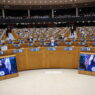 epa09062215 European lawmakers listen to U.S. Vice President Kamala Harris, displayed in screens, during a plenary to mark the International Women's Day at the European Parliament in Brussels, Belgium, 08 March 2021.  EPA/FRANCISCO SECO / POOL