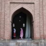 epa09400284 Kashmiri Muslim women offer Friday congregational  prayers at Jamia Masjid, the grand mosque of Srinagar, the summer capital of Indian Kashmir, 06 August 2021. The government allowed the reopening Jamia Masjid following their closure after the second wave of coronavirus but urged the people to wear masks and maintain social distancing norms.  EPA/FAROOQ KHAN